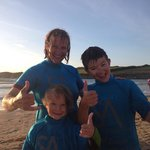 The Davey family stoked after an evening surf at Porth