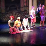 They got my husband on stage - hes the one in the red wig!