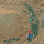 Location of the Qasr in the middle of the Desert Dunes