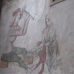 Fresco of coins being made