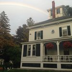 After a brief thunderstorm, a rainbow over the main house. The porch is where breakfast is serve