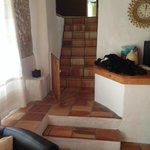 stairs from living area to kitchen