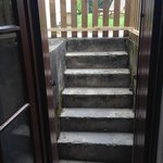 concrete steps to garden with barrier