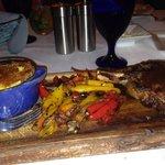 Bone in ribeye , roasted veggies, and oven bake potatoes.