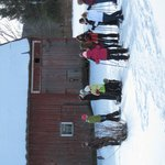 Mom and Daughters snow shoe get-away group heads out.
