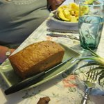 Cranberry orange bread, pineapple boat in the background.