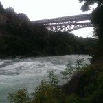 by the bridge