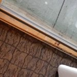 Wood Block Behind Sliding Glass Door