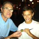 Owner John visits with a young customer