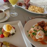 Breakfast on the terrace with huevos motulenos and eggs benedict
