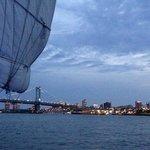 The sail looming over the Philadelphia skyline at dusk.