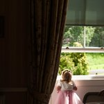 Our flower girl peeping out from a window of the deluxe double
