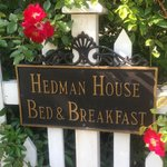 The sign on the charming picket fence that surrounds the property.