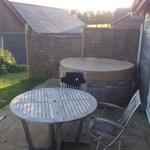 Hot tub and patio area Infront of lodge