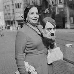 Photo of photo of lady with Hitler mask