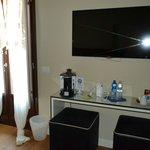 Huge TV, coffee machine, french doors leading to small balcony