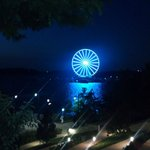 Ferris wheel at night at end of harbor