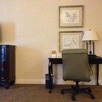 A nice dresser and a desk