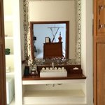 Nice touches abound: mirror reflection shows bed