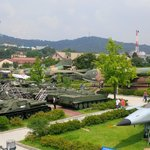 Outside exposition of military vehicles and planes