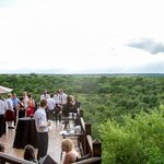 Guests enjoying a drink on the viewing deck