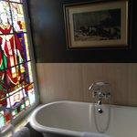 Coucke's original stain glass in the bathroom