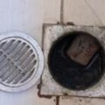 Open drain in bathroom where the top kept coming off