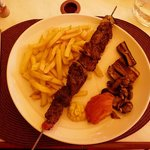Delicious brochette of beef with frites