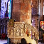 St Giles' well decorated and intricately carved main pulpit attached to a main column of the chu