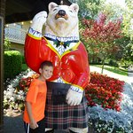 Bear in kilt in front of hotel