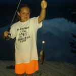 Samantha catching her first fish