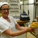 Showing off one of the delicious breads..