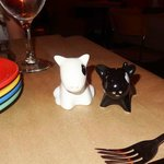 Different quirky designed salt and pepper shaker on each table