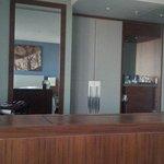 hall way, desk and mini bar