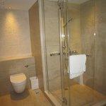 Bathroom with rain shower + shower head