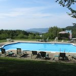 Beautiful pool up on hill from Manoir Le Tricorne