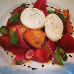 Poached eggs upon a panzanella salad