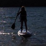 Paddle boarding on the calm lake