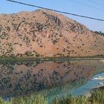 The mountain opposite mirror-imaged in Lake Kournas.