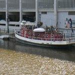 an elderly river boat moored by the Riverside Walk