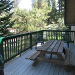 Deck on rear of Ponderosa Cabin with charcoal grill and picnic table
