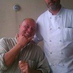 Chef Lance and Robert eating king crab