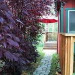path to back deck and hot tub, table