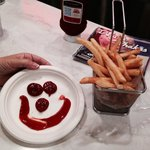 Waitress made smiley face from catsup for the scrumptious French fries!!!!