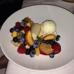 Deconstructed dessert of fresh berries, peaches, almond cake, fruit purée and ice cream. To die