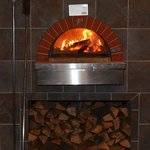 Wood fired oven for pizza and other great items.