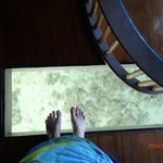 Looking down through window of the floor in our overwater bungalow