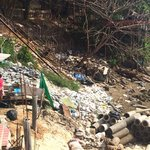 Rubbish pile by hotel, washes up onto beach when tide is in