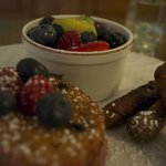 Our delicious breakfast item, Raspberry stuffed French Toast with Sausage links and fruits