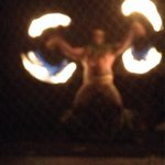 Fire dancer! I sure hope this guy makes good $$!